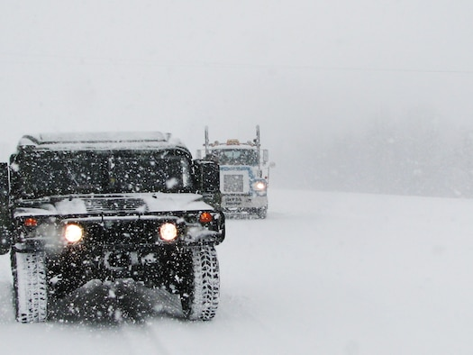 An Arkansas Air National Guard Rapid Augmentation Team vehicle patrols Highway I-40 Feb. 9, 2011, during the initial white-out condition of a snow storm that blanketed the greater Little Rock, Ark., metro area with approximately six inches of snow. The 189th Airlift Wing team's primary mission is to provide emergency response and assistance as directed by the governor of Arkansas. (U.S. Air Force photo by Tech. Sgt. Michael Caffey)