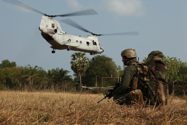 February 16, 2011, A U.S. Marine with the Maritime Raid Force, 31st Marine Expeditionary Unit, 3rd Marine Expeditionary Brigade, provides security as a U.S. Marine Corps CH-46E Sea Knight helicopter lands during a mock raid conducted with Royal Thai Marines in Hat Yao, Kingdom of Thailand, in support of Exercise Cobra Gold 2011. For three decades, Thailand has hosted Cobra Gold, one of the largest land-based, joint, combined military training exercises in the world.  A successful Cobra Gold 2011 results in increased operational readiness of U.S. and Thai forces and matured military to military relations between the two countries.