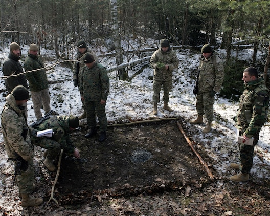 Soldiers with the Republic of Georgia's 33rd Light Infantry Battalion prepare a terrain model prior to a mechanized live-fire drill. These soldiers are currently deployed here from Georgia conducting a mission rehearsal exercise as part of the Georgia Deployment Program- International Security Assistance Force (GDP-I) prior to their deployment to Afghanistan. The GDP-I is a two-year, time-phased, program which prepares four battalions, one every six months, to be able to integrate with ISAF in Afghanistan. The 33rd Light Infantry Battalion is scheduled to replace the 32nd Light Infantry Battalion, which is currently deployed and partnered with other ISAF units.