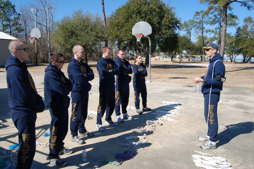 An officer candidate demonstrates basic sailing knots to his fellow officer candidates and midshipmen at the Short Stay Outdoor Recreation Area in Moncks Corner, S.C., Feb. 12.
