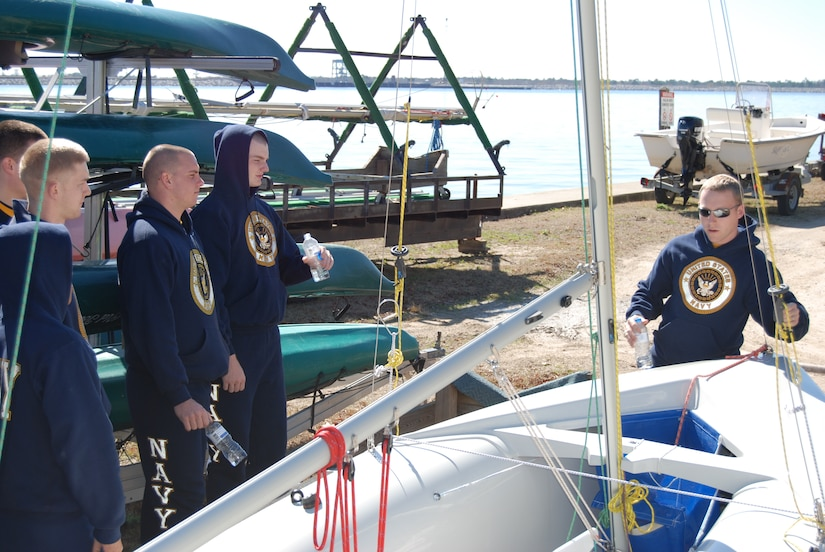 An officer candidate identifies the parts of a sailboat for his fellow midshipmen and officer candidates at Short Stay Outdoor Recreation Area in Moncks Corner, S.C., Feb. 12.