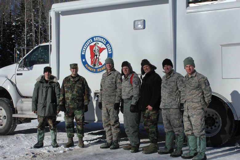 Members of the 148th Fighter Wing, Communication Flight, Deployable Interoperable Communications Element (DICE) take time to pose for a group picture.  The DICE team was deployed to the Grand Marais, Minn. area in support of the John Beargrease Sled Dog Marathon.  U.S. Air Force photo by MSgt Richard Kaufman.  (Released)