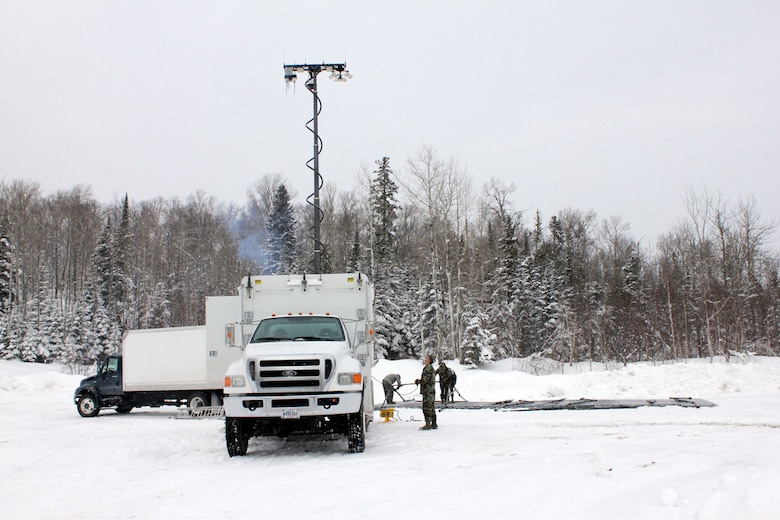 Members of the 148th Fighter Wing, Communications Flight, Deployable Interoperable Communications Element (DICE) are seen setting up equipment at their deployed location in support of the John Beargrease Sled Dog Marathon.  The 148th Communication Flight has been supporting the Beargrease Sled Dog Marathon since 1995.  U.S. Air Force photo by MSgt Richard Kaufman.  (Released)
