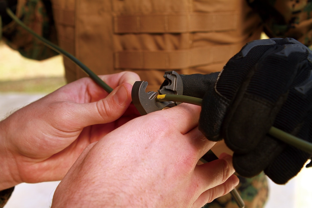 9th ESB Marines and sailors cut several sections of detonating cord to be used as the main line during the training Feb. 16.