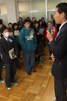 Aoki Toshiki, a Takamori Midori Junior High School student, gives a welcoming speech to the Matthew C. Perry High School students as they pair up with their assigned buddies in a classroom for the days activities at Takamori Midori Junior High School Feb. 16.