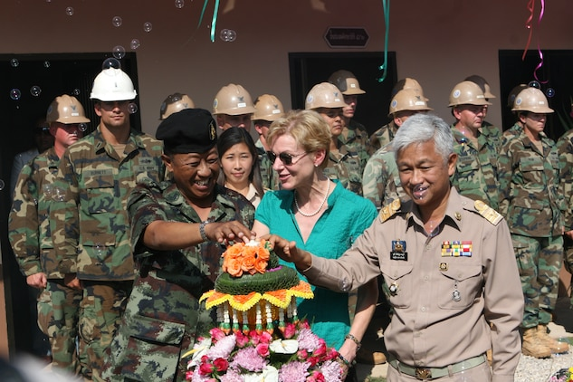 Royal Thai Army Lt. Gen. Parinya Boorananggoon, left, Kristie Kenney, middle, the U.S. ambassador to Thailand, and Woot Sittisurat, the deputy governor of Tak province symbolically open a schoolhouse for the local community here during a dedication ceremony. The schoolhouse was built for an engineering civic assistance project during Exercise Cobra Gold 2011 Feb. 16, 2011. (U.S. Marine Corps photo by Lance Cpl. Kris B. Daberkoe/Released)::r::::n::