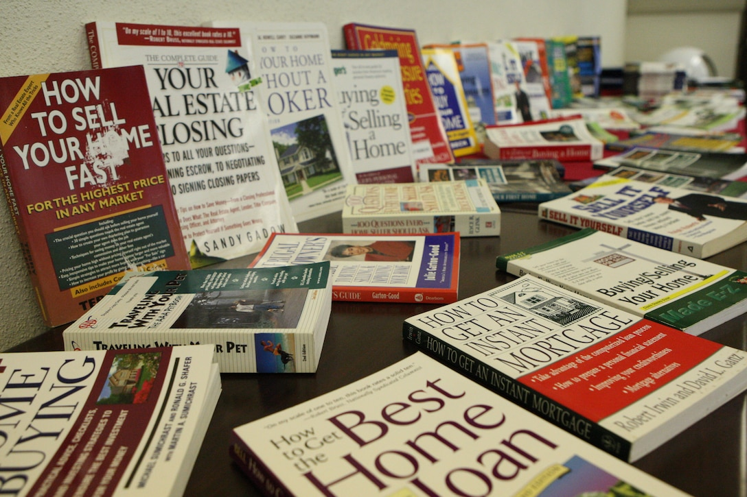 MARINE CORPS BASE CAMP LEJEUNE, N.C. – Books and pamphlets cover a table at the ABC's of Home Buying and Selling workshop hosted by Marine Corps Community Services' Relocation Assistance Program at the Russell Marine and Family Service building aboard Marine Corps Base Camp Lejeune, Feb. recently. The workshop covers aspects such as the legal rights as far as what a buyer or seller can and cannot do, tips on home inspection and financial preparation. (U.S. Marine Corps photo by Pvt. Nik S. Phongsisattanak)::r::::n::