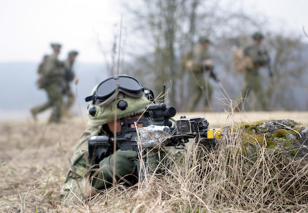 A Georgian soldier assigned to the 33rd Light Infantry Battalion provides security during a training patrol at the Joint Multinational Training Center, here. The soldier is participating in the Georgia Deployment Program- Mission Readiness Exercise, where a majority of the Marines serving as observer/controllers were from 3rd Bn, 7th Marine Regiment, mentoring the 33rd LIB before they head to Afghanistan this spring.