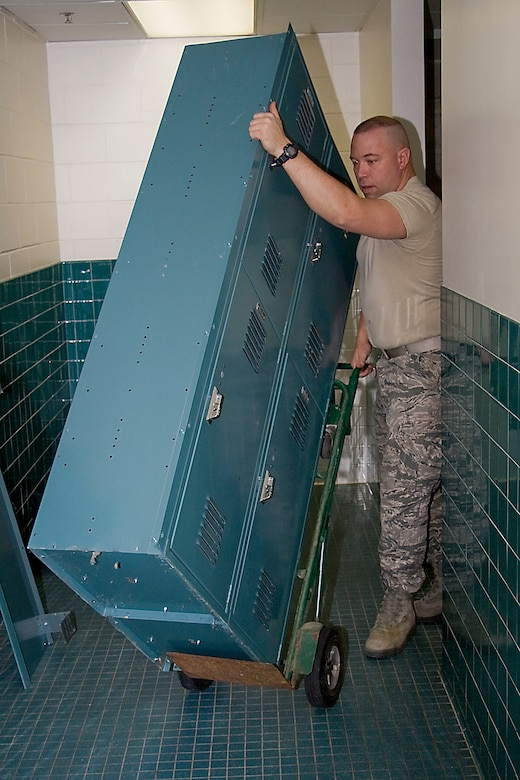GRISSOM AIR RESERVE BASE, Ind. -- Airman 1st Class David Kessen, 434th Civil Engineer Squadron engineer apprentice, removes old lockers from the base fitness center here Feb. 14. New wooden lockers were recently installed, which provide double the storage space to the user and replaced metal lockers that were originally installed when the facility was a child development center. (U.S. Air Force photo/Tech. Sgt. Mark R. W. Orders-Woempner)