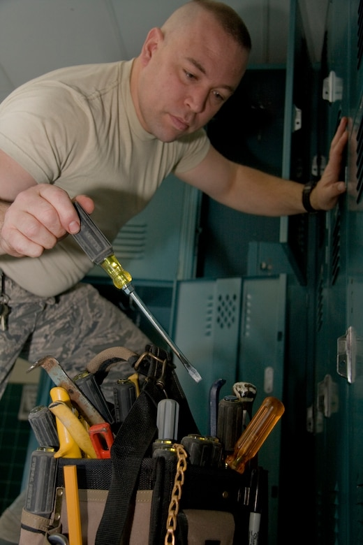 GRISSOM AIR RESERVE BASE, Ind. -- Airman 1st Class David Kessen, selects a flat-head screwdriver as the right tool for the job as he removes old lockers from the base fitness center here Feb. 14. New wooden lockers were recently installed, which provide double the storage space to the user and replaced aging metal lockers that were originally installed when the facility was a child development center. Airman Kessen is a engineer apprentice with the 434th Civil Engineer Squadron. (U.S. Air Force photo/Tech. Sgt. Mark R. W. Orders-Woempner)