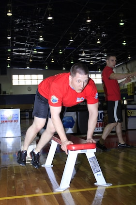 Cpl. Darren Guffey, Marine Wing Support Squadron 171 competitor, busts out bench leaps at the Strength and Endurance Commander's Cup challenge at IronWorks Gym here Feb. 18. MWSS-171 took first place with an accumulated 1,364 repetitions.