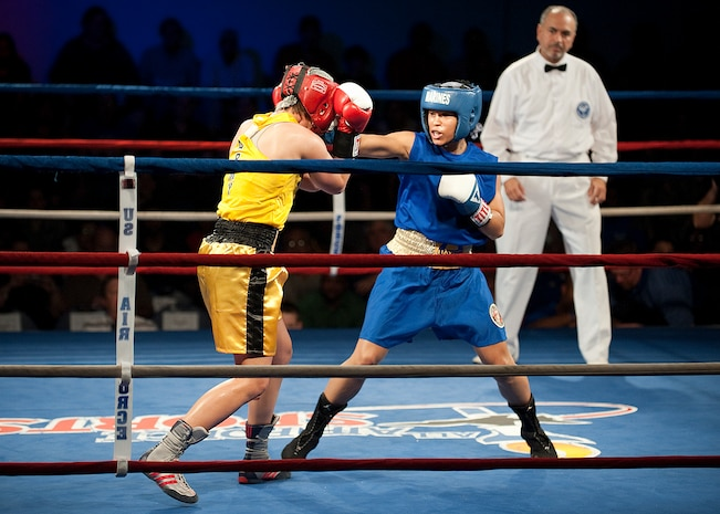 Lance Cpl. Melissa O. Parker lands a punch on her opponent, Army Reserve Spc. Caroline R. Barry, during her bout at the 2011 Armed Forces Championships at Lackland Air Force Base, Texas, Feb. 18.