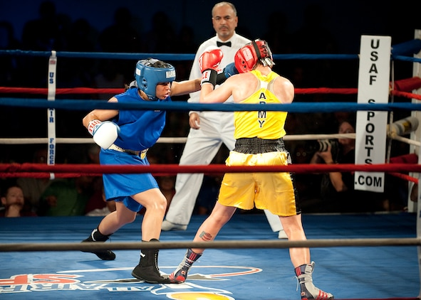 Lance Cpl. Melissa O. Parker takes advantage of a hole in her opponent's defense to land a punch during her Feb. 18 bout against Army Reserve Spc. Caroline R. Barry at the 2011 Armed Forces Championships at Lackland Air Force Base, Texas.
