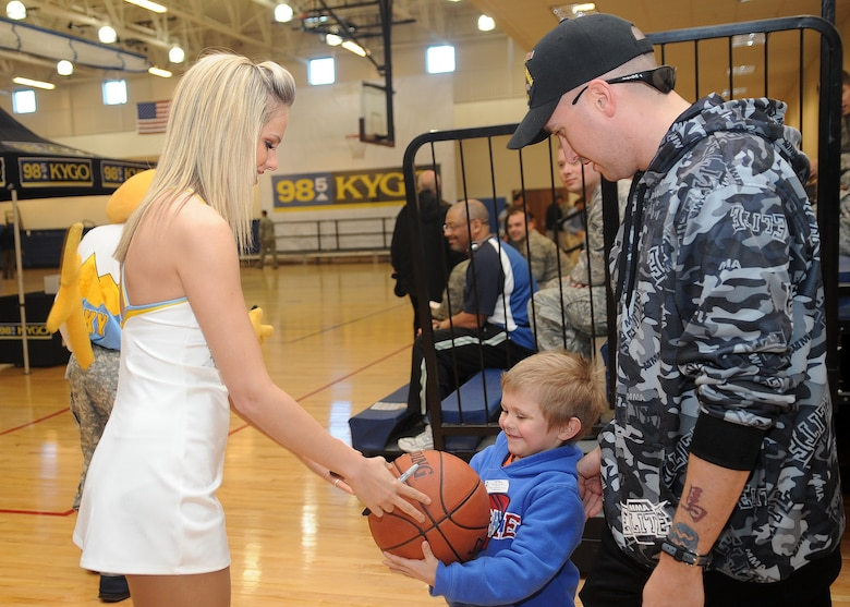 Buckley Air Force Base, Colo.- Members of the Denver Nuggets dance team signed memorabilia for military members and their families  February 17, 2011. The local radio station, 98.5 KYGO and the Denver Nuggets came together to host the military appreciation day event. ( U.S. Air Force Photo by Airman 1st Class Marcy Glass )