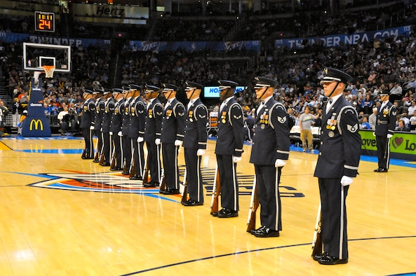 The U.S. Air Force Honor Guard drill team performs the halftime show Feb. 15 on the Oklahoma City Thunder court for military appreciation night. The drill team performs to represent the Airmen serving around the world. (U.S. Air Force photo by Airman 1st Class Tabitha N. Haynes)