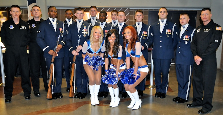 The U.S. Air Force Honor Guard drill team was cheered on the Oklahoma City Thunder Cheerleaders Feb. 15 at the thunder stadium. The drill team performed the halftime show during the game, representing service members for military appreciation night. (U.S. Air Force photo by Airman 1st Class Tabitha N. Haynes)