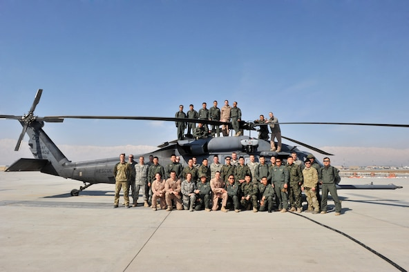 Members from the 83rd Expeditionary Rescue Squadron and soldiers from the Republic of Korea Army post for a picture on front of an HH-60G Pave Hawk at Bagram Airfield, Afghanistan, Feb. 17, 2011. The 83rd ERS hosted the event to build a lasting relationship with the Koreans. (Air Force photo by Senior Airman Sheila deVera)