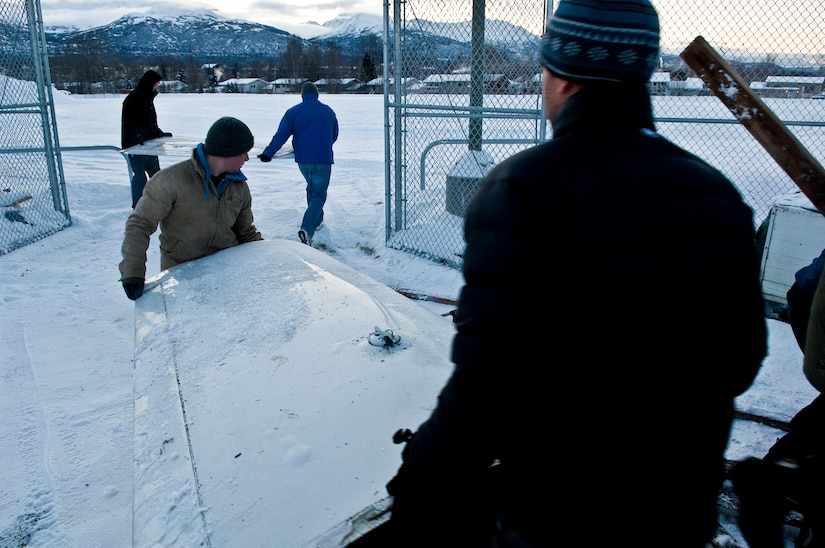 ANCHORAGE, Alaska -- Volunters from Joint Base Elmendorf-Richardson move an ultra-light model plane to Begich Middle School for the Build-a-Plane program. The Build-a-Plane program is designed to inspire children to become involved in aviation. (U.S. photo/Airman 1st Class Jack Sanders)