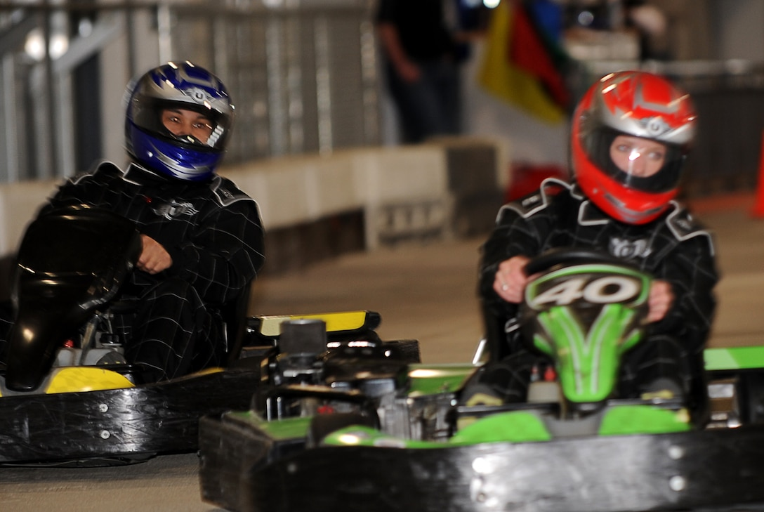 Denver, Colo.- Staff Sergeant Freddie Gomez, 460th Communication Sqaudron and Airman 1st Class Kailey Miller, 566 Intelligence Sqaudron sped around on the indoor track at Unser Racing Feb 20, 2011. The event,  Racing for Heros, was created by Craig Mansfield to send the message not to drink and drive.   ( U.S. Air Force Photo by Airman 1st Class Marcy Glass )
