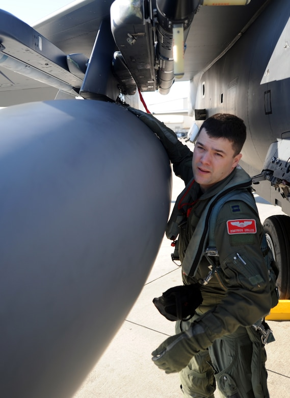 Capt. Tacos Grillos performs a final inspection on his F-15E Strike Eagle before entering the cockpit for training on the flight line Feb. 23 on Joint Base Charleston - Air Base, S.C. The Strike Eagle is a dual-role fighter designed to perform air-to-air and air-to-ground missions. An array of avionics and electronics systems gives the aircraft the capability to fight at low altitudes, day or night, in all weather. Captain Grillos is a student pilot with the 333rd Fighter Squadron from Seymour Johnson Air Force Base. (U.S. Air Force photo/Senior Airman Timothy Taylor)
