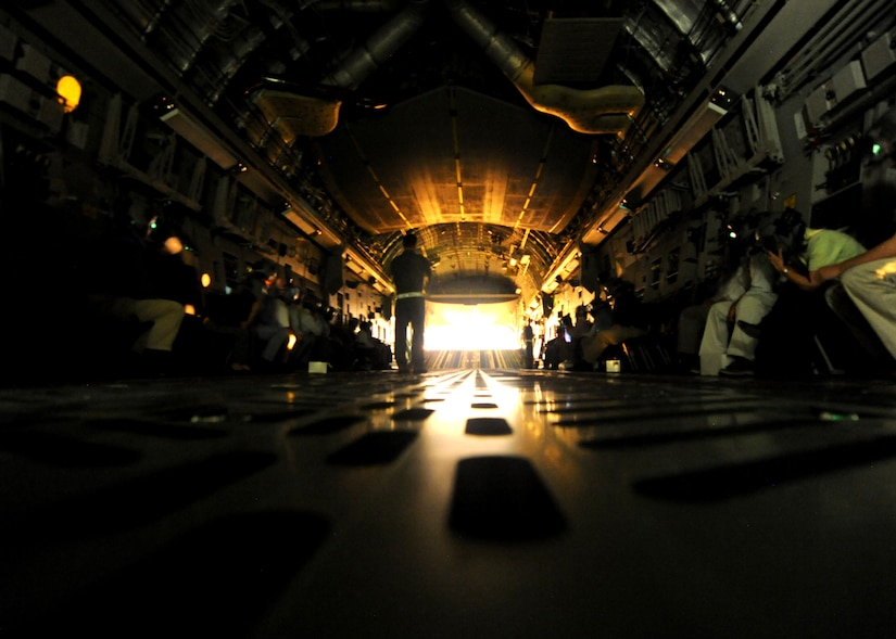 The lights go dark for honorary commanders during night vision goggle training onboard a C-17 Globemaster III Feb. 22, 2011 on Joint Base Charleston, S.C. Honorary commanders were given the opportunity to dine in on the C-17 and ask the crew questions about the aircraft and their missions. (U.S. Air Force photo/Senior Airman Timothy Taylor)