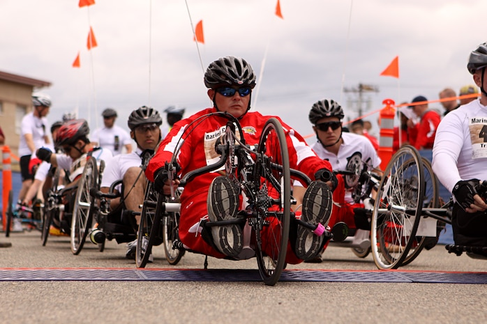Nathan Peck, a cyclist, shot-put and discus thrower for the Battalion West Team, awaits the command with other participants at the start line of the 2011 Marine Corps Trials 10 kilometer hand-cycling portion of the race at Camp Pendleton, Feb. 23. Peck, a native of Salmon, Idaho, suffered lower back injuries and Post Traumatic Stress Disorder after a 2009 tour of duty in Iraq.