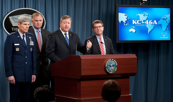 Secretary of the Air Force Michael Donley (at podium) answers a question from a reporter after he announced during a press conference in the Pentagon Feb. 24, 2011, that the KC-46A tanker contract was awarded to The Boeing Company. Behind Secretary Donley (from the left) are Air Force Chief of Staff Gen. Norton Schwartz, Deputy Secretary of Defense William Lynn and Undersecretary of Defense for Acquisition, Technology and Logistics Ashton Carter.  (U.S. Air Force photo/Jim Varhegyi)