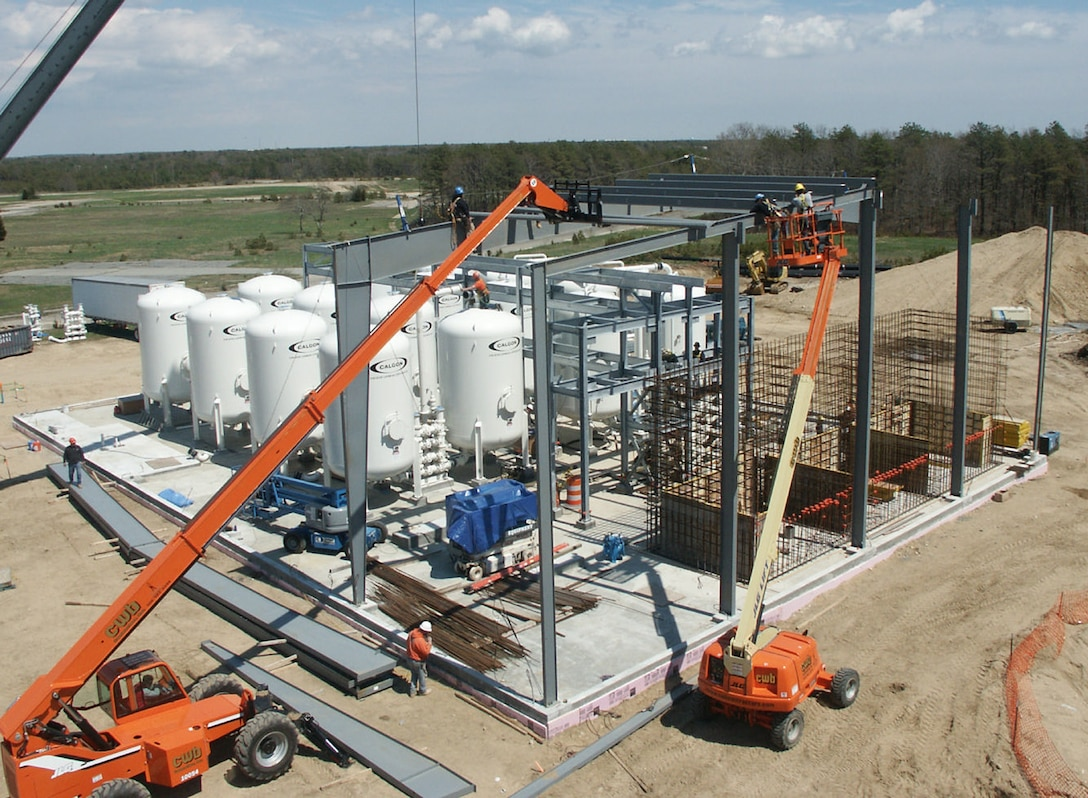MASSACHUSETTS MILITARY RESERVE, Mass. -- The Air Force Center for Engineering and the Environment's largest groundwater treatment plant under construction in 2005. It houses 16 tanks each containing 20,000 pounds of granular activated carbon and treats contaminated groundwater from several groundwater plumes here. (Air Force photo by Frank J. Adinolfi)
