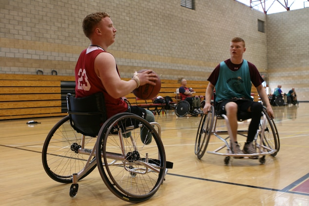 MARINE CORPS BASE CAMP PENDLETON, Calif. (Feb. 24) -- Corporal Josh Wege and Lance Cpl. Austin Allen participate in the Marine Corps Trials wheelchair basketball competition.  The Marine Corps Trials is a part of the Regiment's Warrior Athlete Reconditioning program which provides opportunities for wounded, ill and injured Marines to engage in both physical and cognitive activities outside the traditional therapy setting.   The Wounded Warrior Regiment hosted the Marine Corps Trials to select athletes for the All-Marine Warrior Games team.  The Warrior Games will be held in Colorado Springs, Colo. May 16-21.