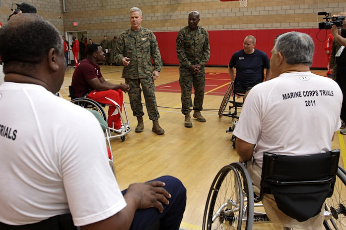 Gen. James F. Amos, 35th Commandant of the Marine Corps; and Sgt. Maj. Carlton W. Kent, Sgt. Maj. of the Marine Corps; both speak to injured Marines competing in the 2011 Marine Corps Trials at Camp Pendleton's Paige Field House, Feb. 25. Amos and Kent paid a visit in an effort to boost the morale of those competing. The trials are intended to select the top 50 Marine athletes to compete in the games as the All-Marine team for the Paralympics-style competition slated for May 2011. Marines competed along with allied forces and retirees in different sports including swimming, wheelchair basketball and sitting volleyball.