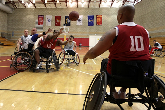 Injured Veteran Marines compete in the wheelchair basketball portion of the 2011 Marine Corps Trials at Camp Pendleton's Paige Field House, Feb. 24. The trials are intended to select the top 50 Marine athletes to compete in the Wounded Warrior Games as the All-Marine team for the Paralympics-style competition slated for May 2011.