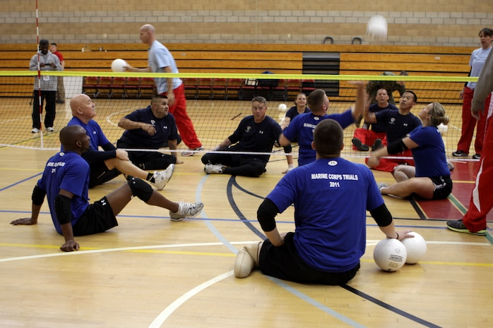 Injured Veteran Marines practice for the sitting volleyball portion of the 2011 Marine Corps Trials at Camp Pendleton's Paige Field House, Feb. 25. The trials are intended to select the top 50 Marine athletes to compete in the Wounded Warrior Games as the All-Marine team for the Paralympics-style competition slated for May 2011.
