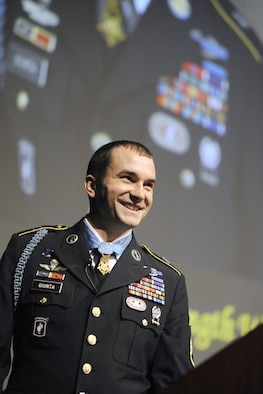 Army Staff Sgt. Salvatore Giunta addresses the Air Force Academy Cadet Wing and guests during his keynote speech at the National Character and Leadership Symposium in Arnold Hall Feb. 24, 2011. Sergeant Guinta, the first living Medal of Honor recipient since the Vietnam War, was one of three Medal recipients to speak at the Center for Character and Leadership Development's keystone event. (U.S. Air Force photo/Dennis Rogers)