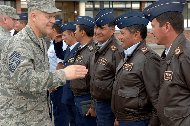 BOGOTA, Colombia -- Chief Master Sgt. of the Air Force James Roy greets Colombian Air Force staff at the Escuela de Suboficiales Feb. 1. The Escuela de Suboficiales is a three-year NCO academy which grants undergraduate degrees in military specialties to more than 100 students a year. Chief Roy's visit focused on strengthening relationships between U.S. and Columbian Airmen. (U.S. Air Force photo/Tech. Sgt. Eric Petosky)