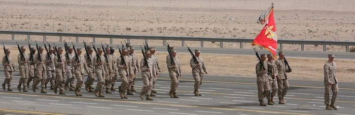 Marines with Marine Corps Central Command Forward march during the 50/20 Celebration Feb. 26. The 50/20 parade signifies the 50th National Day and 20th Anniversary of the Liberation of Kuwait. The U.S. support of this celebration is symbolic of the historical importance of Desert Shield/Desert Storm.