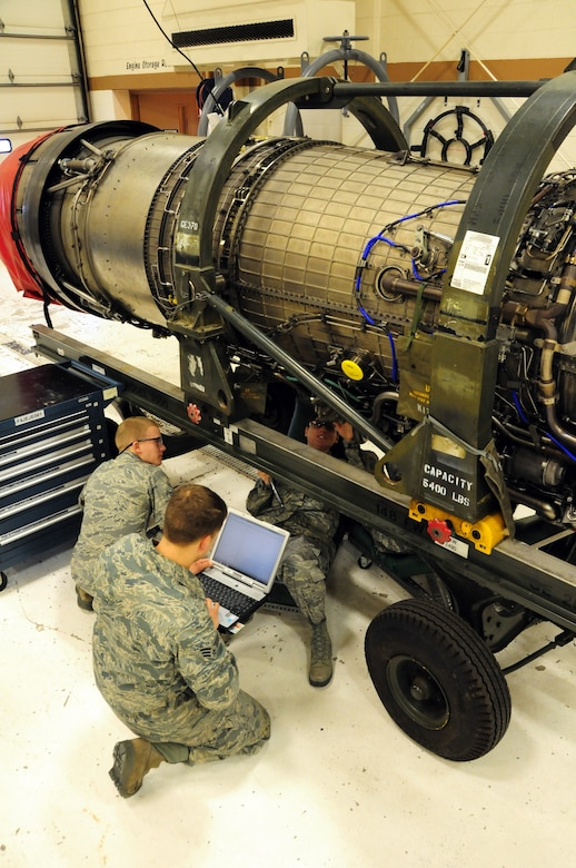 Airman1st Class Matthew McEwen, Senior Airman John Broberg and Airman 1st Class Alicia Jenness conduct repairs on a dismantled F-16 Block 50 engine.  The engine repairs were being completed at the 148th Fighter Wing in Duluth Minn. Feb. 26, 2011.  (U.S. Air Force photo by Staff Sgt. Donald Acton/released)