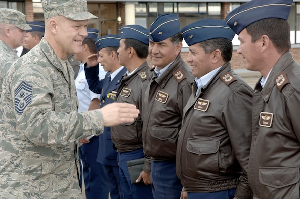 Chief Master Sgt. of the Air Force James A. Roy greets Colombian air force staff members Feb. 1, 2011, in Bogota. (U.S. Air Force photo/Tech. Sgt. Eric Petosky)