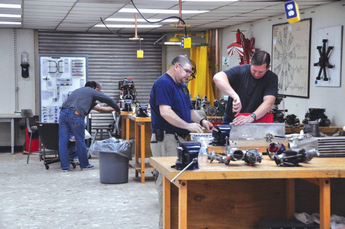 Students at the School of Aviation Technology at the former George Air Force Base in Victorville, Calif. get hands-on training as aircraft mechanics. Most members of the school's first graduating class secured jobs within the region almost immediately.  (Photo by Scott Johnston)