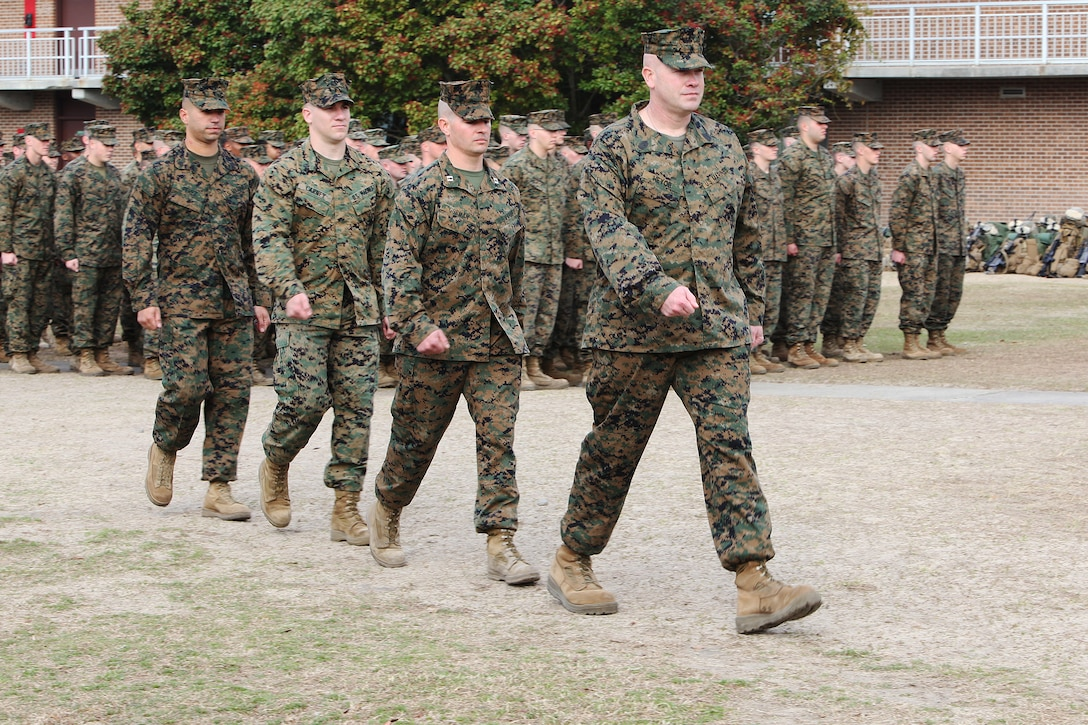 (From right to left) Sergeant Major William E. Heyob, Capt. Brandon J. Gorman, Cpl. John D. Carney and Sgt. Joseph M. Perez, all with Battalion Landing Team, 2nd Battalion, 2nd Marine Regiment, 22nd Marine Expeditionary Unit, prepare to receive personal awards from Lt. Gen. John M. Paxton, commanding general, II Marine Expeditionary Force, Feb. 28, 2011.  The Marines received the awards for their heroic actions while deployed to Afghanistan in 2009 and 2010.  The Marines and sailors of the 22nd MEU are in their pre-deployment training program, which is a series of progressively complex exercises designed to train and test the MEU's ability to operate as a cohesive and effective Marine Air Ground Task Force.