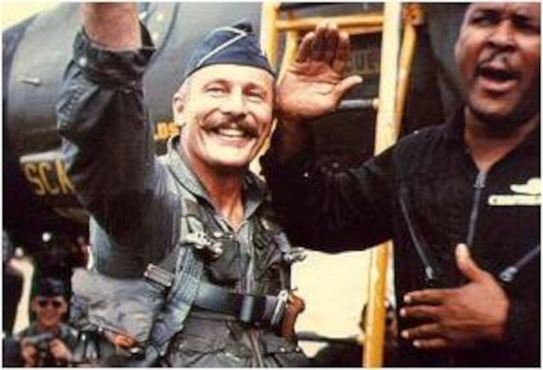 Col. Robin Olds, 8th Tactical Fighter Wing commander, is carried off the airfield after successfully completing Operation Bolo Airmen Jan. 2, 1967.  During Operation Bolo, Colonel Olds dubbed the wing the Wolf Pack because of its aggressive tactics and high degree of teamwork. (U.S. Air Force photo)