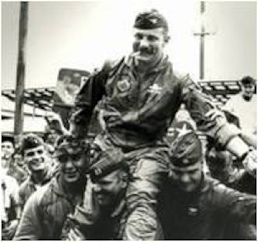 Col. Robin Olds, 8th Tactical Fighter Wing commander, is carried off the airfield after successfully completing Operation Bolo Airmen Jan. 2, 1967.  It was during Operation Bolo, when Colonel Olds dubbed the wing the Wolf Pack because of its aggressive tactics and high degree of teamwork. (U.S. Air Force photo)