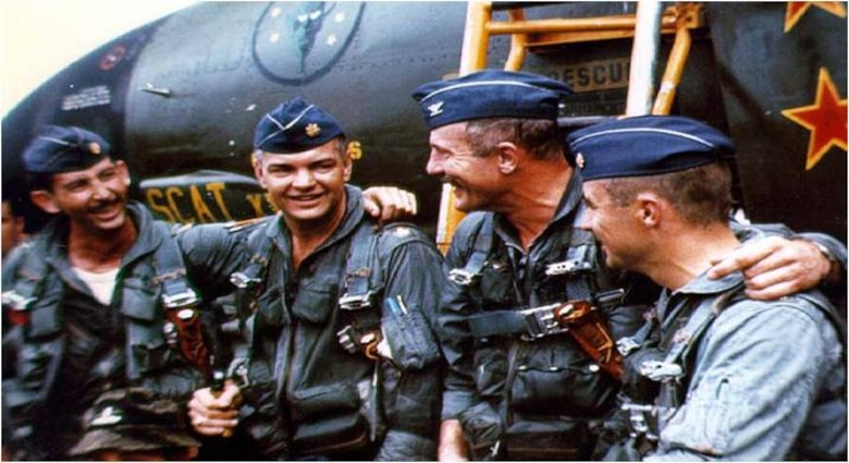 Col. Robin Olds  (second from right) celebrates with his Airmen after completing Operation Bolo. Colonel Olds was the commander of the 8th Tactical Fighter Wing at Ubon Air Base, Thailand, and was credited with shooting down four enemy MiG aircraft in aerial combat over North Vietnam. (U.S. Air Force photo)