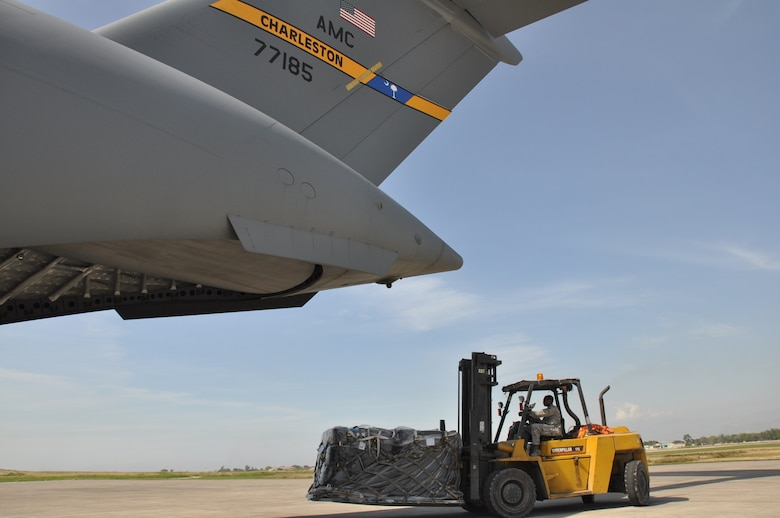 Tech. Sgt. Darrius Warren with the 81st Aerial Port Squadron, Joint Base Charleston, S.C. commands a forklift with humanitarian aid out of a C-17 Globemaster III aircraft during a humanitarian aid mission to Haiti and Grenada Dec. 30, 2010. (U.S. Air Force photo/Senior Airman Robert Pilch)