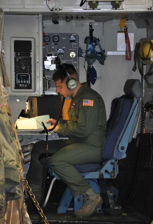 Senior Airman Cody Rogers, a loadmaster with the 701st Airlift Squadron, prepares pre-flight checklists and reviews cargo information prior to departure on a humanitarian aid mission to Haiti and Grenada Dec. 30, 2010.  The loadmaster is responsible for determining quantity of cargo and passengers or troops to be loaded and proper placement in the aircraft. Considers factors such as fuel load, aircraft structural limits, and emergency equipment required. (U.S. Air Force photo/Senior Airman Robert Pilch)