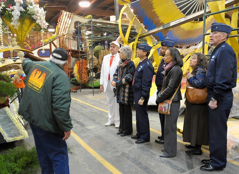 (From left to right) Mr. Paul Sherrod, Tournament of Roses tour guide, explains the intricacies of float decoration to Mr. Gary Leonard, TOR host, Mrs. and Lt. Gen. Tom Sheridan, Brig. Gen. and Mrs. Sam Greaves, and Mrs. and Brig. Gen. Scott Vander Hamm, while the group visits the TOR's Decorating Places Dec. 31, 2010. (Photo by Joe Juarez)