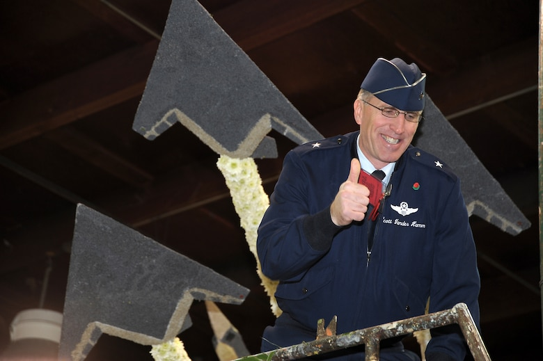 Brig. Gen. Scott Vander Hamm, Commander of the 509th Bomber Wing, Whiteman Air Force Base, Mo., poses for a photo on a float that features Air Force aircraft such as F-117, F-22 and B-2 while visiting the Tournament of Roses' Decorating Places Dec. 31, 2010. A B-2 from the 509 BW performed the flyover over this year's 122nd annual parade. (Photo by Joe Juarez)