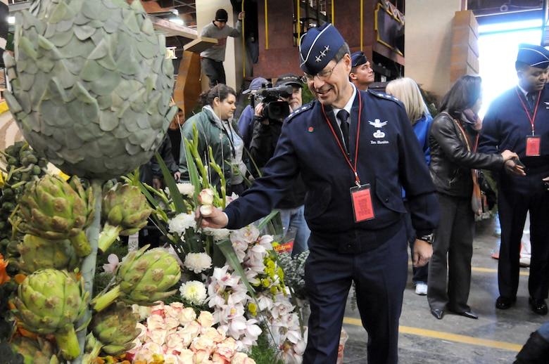 Lt. Gen. Tom Sheridan, Commander of the Space and Missile Systems Center, Los Angeles Air Force Base, places a rose on a parade float while visiting the Tournament of Roses' Decorating Places Dec. 31, 2010. (Photo by Joe Juarez)