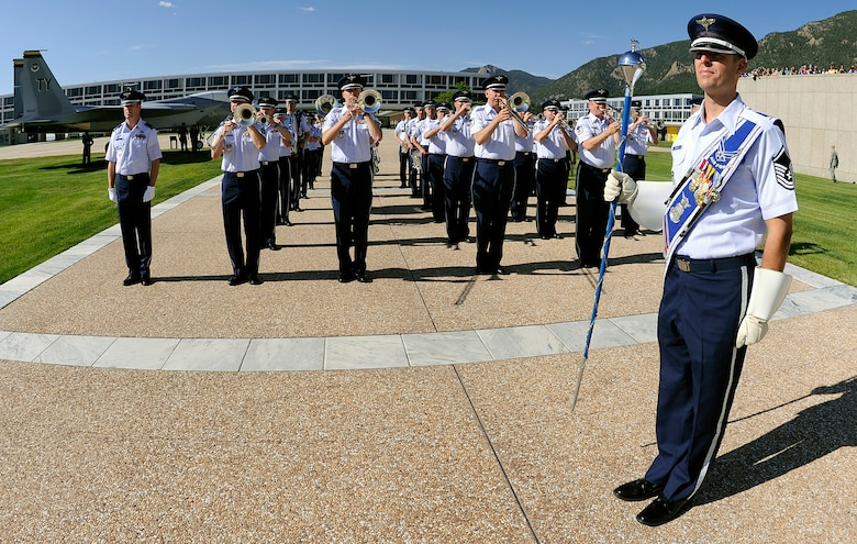 The U.S. Air Force Academy Band performs for the Class of 2014 swearing-in ceremony at the Academy in Colorado Springs, Colo., June 25, 2010. The Air Force Academy band, one of 12 active-duty Air Force bands around the world, is stationed at nearby Peterson Air Force Base. (U.S. Air Force photo/Mike Kaplan)