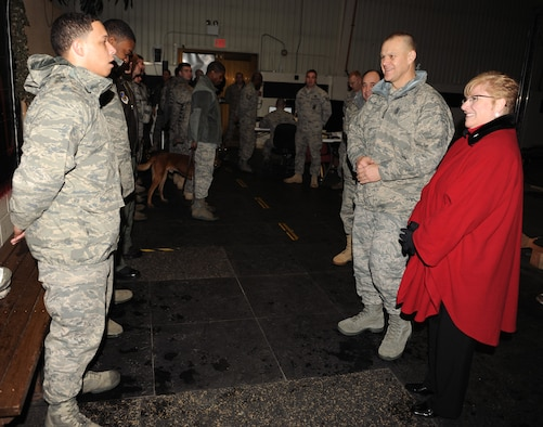 Airman First Class Zachary Tealer gives a mission briefing to Chief Master Sgt. of the Air Force James A. Roy and his wife, Paula, Dec. 30, 2010, during their visit to Kunsan Air Base, South Korea. Chief and Mrs. Roy visited Kunsan AB Dec. 29 and 30, during their year-end tour of Pacific Air Forces bases. Airman Tealer is an 8th Security Forces Squadron responder. (U.S. Air Force photo/Senior Airman Ciara Wymbs)