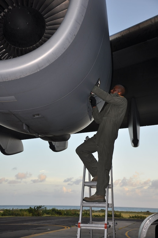 Master Sgt. Bernard L. Matthews, the flying crew chief from the 315th Aircraft Maintenance Squadron, Joint Base Charleston, S.C. services one of the large jet engines on  a C-17 Globemaster III aircraft during a humanitarian aid mission to Haiti and Grenada Dec. 30, 2010. (U.S. Air Force photo/Senior Airman Robert Pilch)